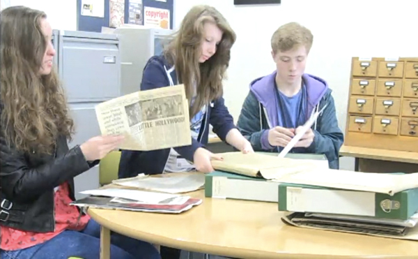 Oaklands College film students Alexandra, Jess & Rhys working on their documentary material in the WGC Library Local Studies Collection