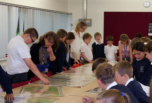 Pupils from St. John's School, Lemsford visiting WGC Library to view maps of WGC's industrial area before setting off on a guided walk with local historian Angela Eserin