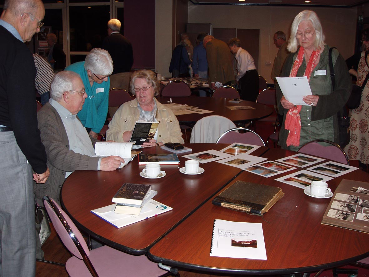 Looking at current and archive photographs of the town.